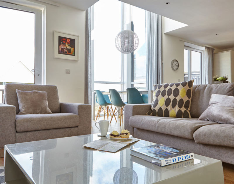 The fashionably decorated open-plan living area of Epphaven, a stunning holiday house to rent at Polzeath, Cornwall