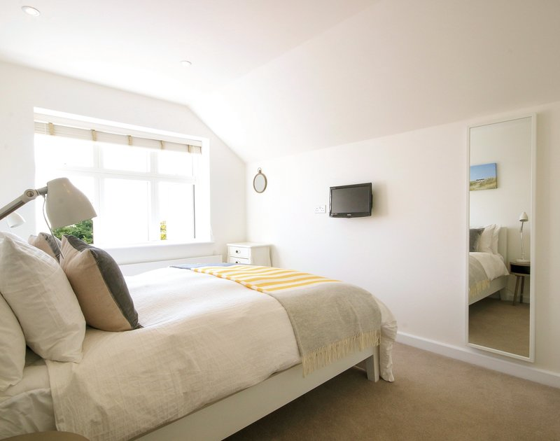One of two king size bedrooms in 3, The Sands, a luxury self catering holiday house to rent in Polzeath on the North Cornish coast.