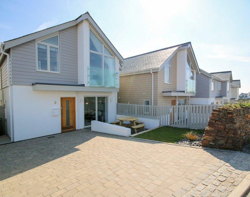 The front, exterior view of 3 The Sands. a contemporary self catering holiday house in Polzeath Cornwall with parking.