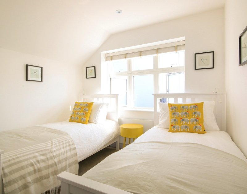The chic and comfortable twin bedroom in 3, The Sands, a self catering holiday house in Polzeath Cornwall.