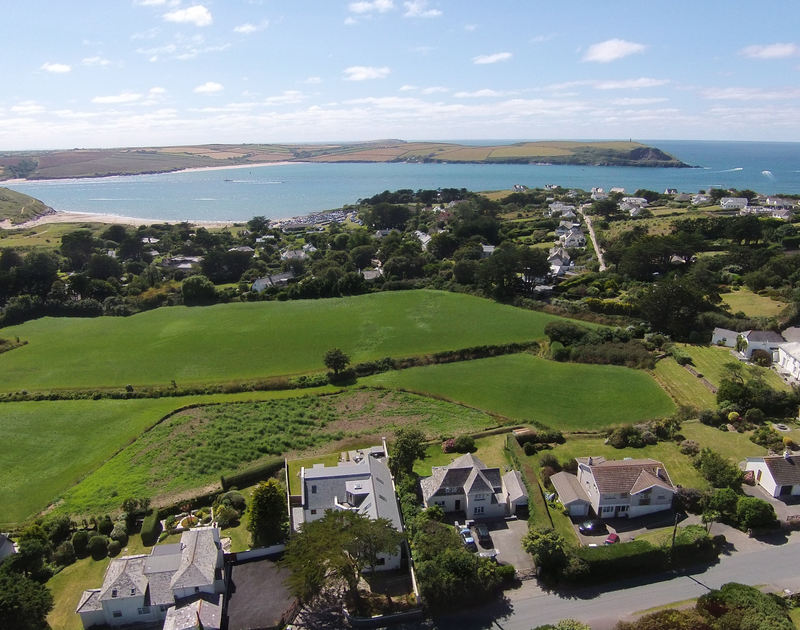 An aerial view of holiday house Bay View Cottage's position near Daymer Bay and the beautiful Camel Estuary.