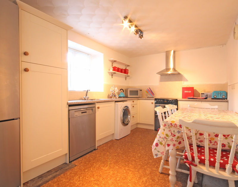 The cosy kitchen in St Michaels, a holiday house in Porthilly near Rock in Cornwall.