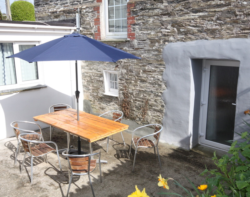 The enclosed, sunny courtyard at St Michaels, a holiday house in Porthilly near Rock in Cornwall.