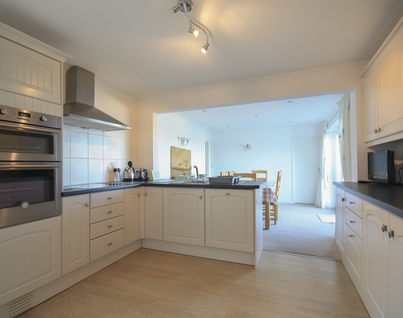 The contemporary open plan kitchen and dining room at Tremelyn in Polzeath on the North Cornwall coast.