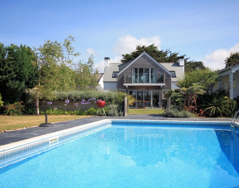 Exterior view showing the pool at Trerokken, a luxury self catering holiday house in Rock, North Cornwall
