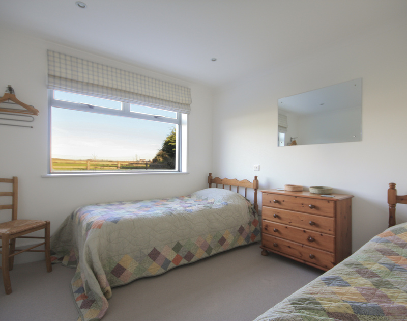 The comfortable twin bedroom with rural views in Yaffles, a self catering holiday house to rent in Daymer Bay, North Cornwall.