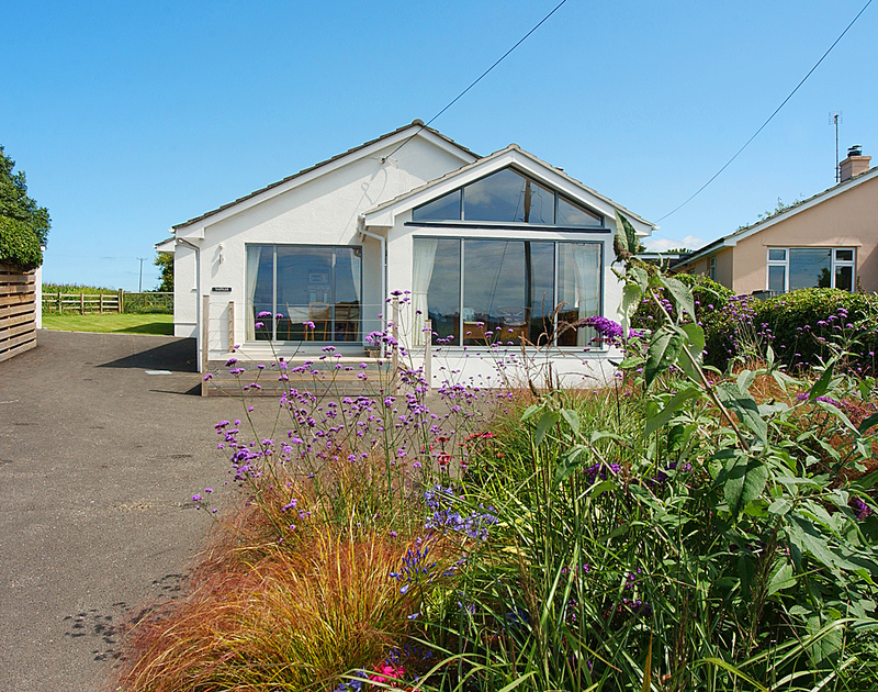 The exterior, driveway and front garden of Yaffles, a self catering holiday house to rent in Daymer Bay, Cornwall.