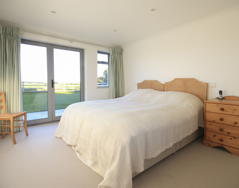 The generous master bedroom with zip and link super king bed in Yaffles, a holiday house to rent in Daymer Bay, North Cornwall.
