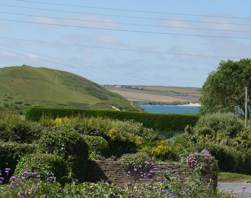 The stunning views of the garden, Brea Hill and the Camel Estuary from Yaffles, a self catering holiday house to rent in Daymer Bay, Cornwall/