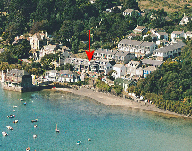 An aerial view of Slipway 6, an end-of-terrace cottage to rent in Rock, Cornwall, with its prime position near the shore.