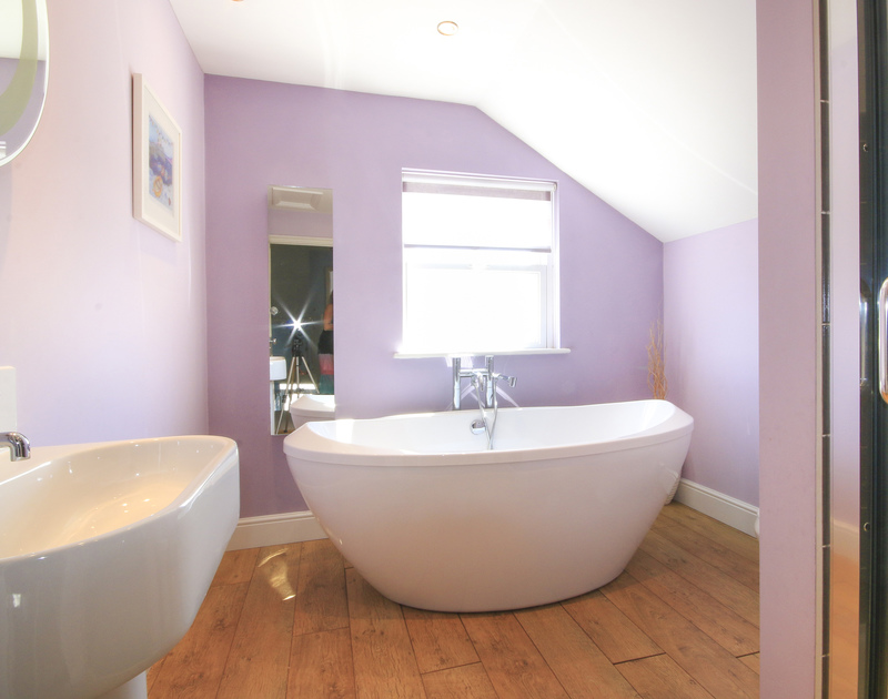 A bathroom to linger in at Crewsnest, luxury holiday house in Rock, Cornwall, with its freestanding contemporary bathtub.