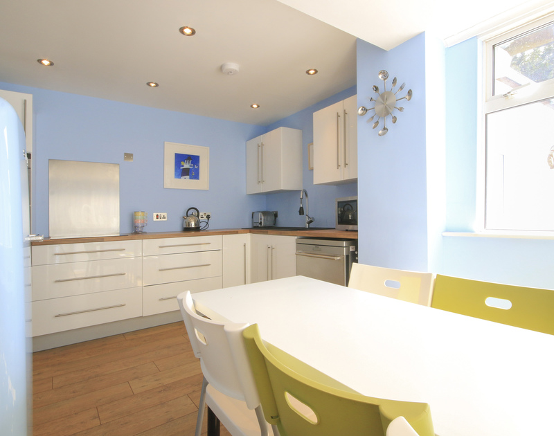 The colourful, modern and sunny kitchen of Crewsnest, a holiday rental in Rock, Cornwall
