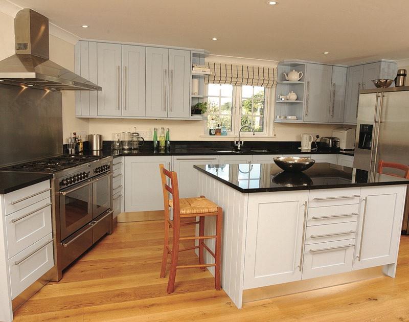 Smart and well-equipped kitchen of Bodare 8, a holiday apartment at Daymer Bay, Cornwall, with its large central island.