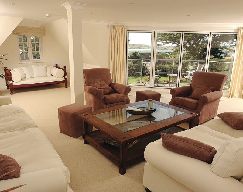 Sumptuously furnished lounge of Bodare 8, holiday apartment at Daymer Bay, with seaviews from the balcony.