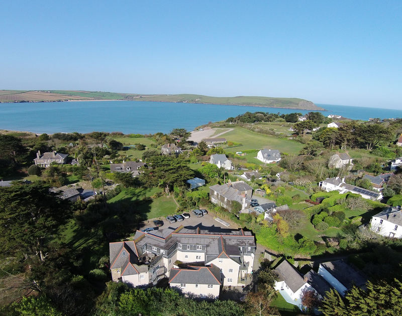 Aerial view over the rear exterior of Bodare 8, holiday apartment located just behind Daymer Bay and the Camel Estuary.