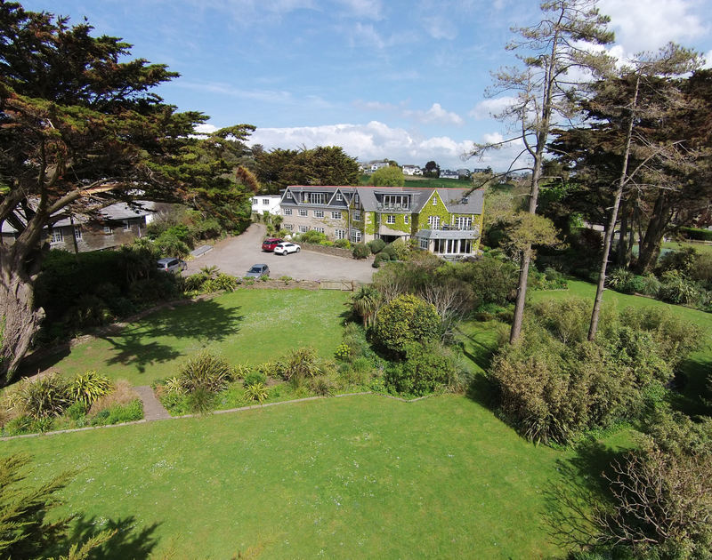 Aerial view of Bodare 8 and garden, a luxury top floor holiday apartment next to Daymer Bay, Cornwall