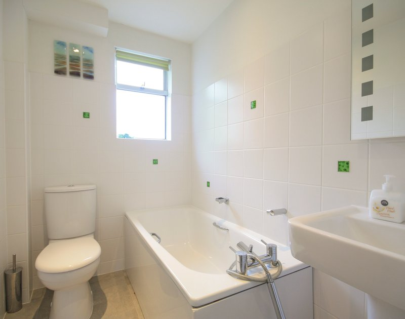 Attractively tiled bathroom at Slipway 23, a holiday cottage to rent in Rock, Cornwall