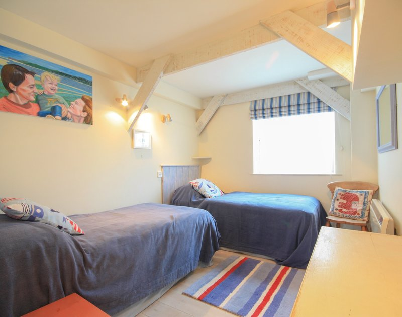 Colourfully decorated twin room of Slipway 23, a holiday rental in Rock, Cornwall