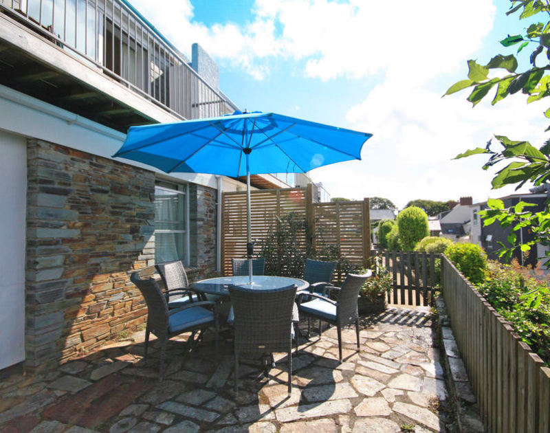 The slate paved sunny terrace at Slipway 12, a self catering holiday cottage to rent in Rock, North Cornwall.