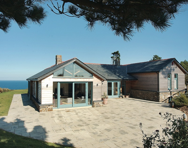 The stunning contemporary front view of Ossco, a luxury self catering holiday house to rent, set above Lundy Bay near Polzeath on the North Cornish Coast.