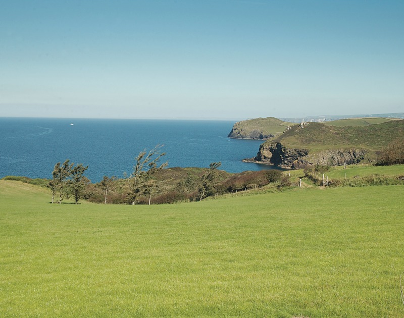 The dramatic sea and coastal views from the huge lawns at Ossco, a luxury self catering holiday house to rent in beautiful Lundy Bay, Polzeath, Cornwall.