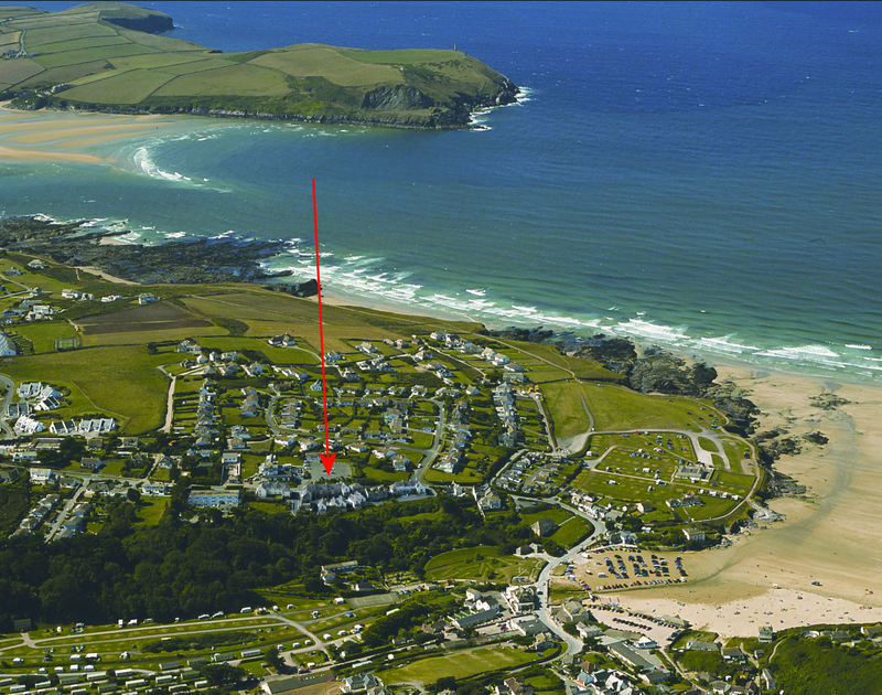 A fantastic aerial view taken on a very low tide showing Polzeath, the mouth of the Camel Estuary, Stepper point and the exact location of Pinewood Flat 3, a self catering holiday rental in Polzeath, Cornwall.