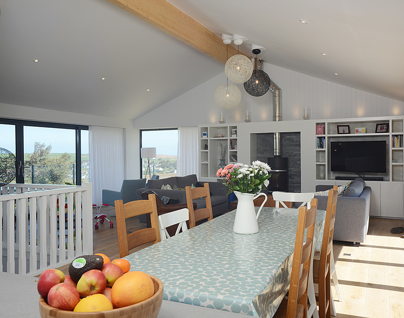 The open plan dining area with seaviews at The Crest, a spacious holiday house in Polzeath, Cornwall