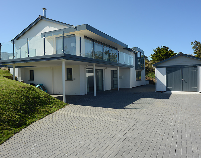 The front exterior and driveway of The Crest, a contemporary style holiday house in Polzeath, Cornwall
