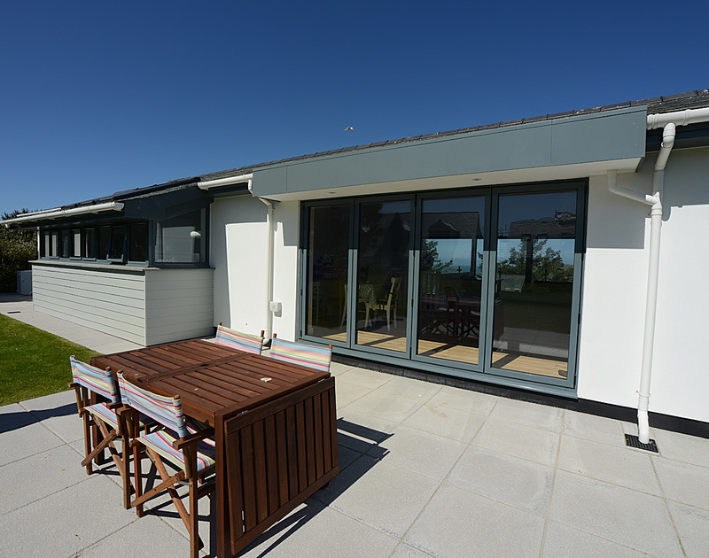 The spacious, furnished patio of The Crest, a holiday house in Polzeath, Cornwall