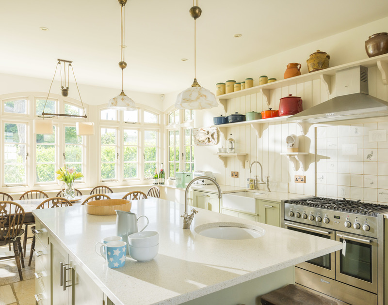 The open plan kitchen/diner of Torquil, a classic coastal holiday house at Daymer Bay, Cornwall, with large central island.