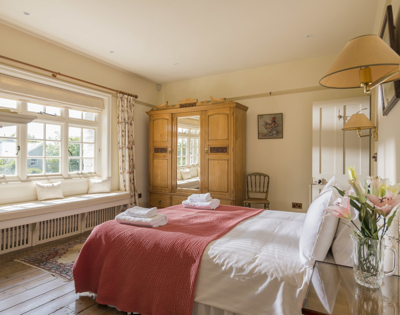 A large, light double bedroom at Torquil, a stunning holiday house at Daymer Bay, Cornwall