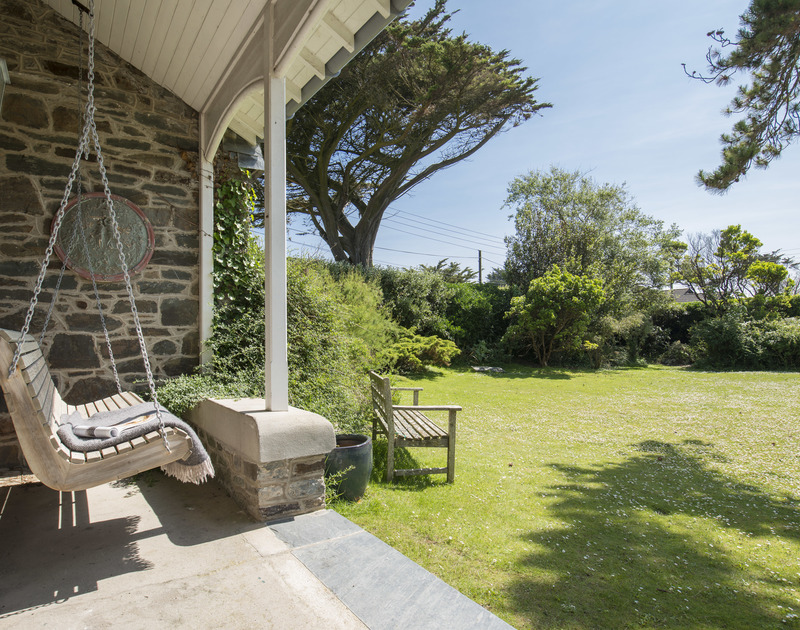 A hanging swing seat overlooking the garden of Torquil, a coastal country house to rent at Daymer Bay, Cornwall