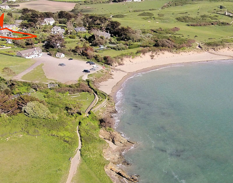 An aerial view of Torquil, a stunning holiday house at Daymer Bay, Cornwall, with the beach closeby.