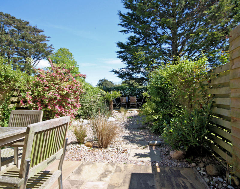 The furnished patio and shingle garden at Lowenna Manor 3, a holiday house in Rock, Cornwall