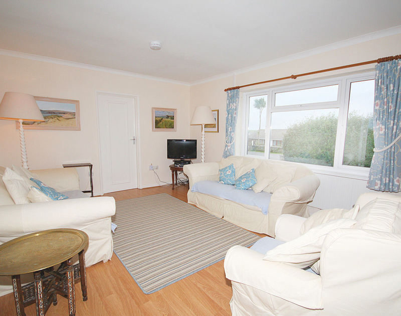 The comfortable sitting room at Trebartha, a self catering holiday bungalow to rent in Daymer Bay, Cornwall.