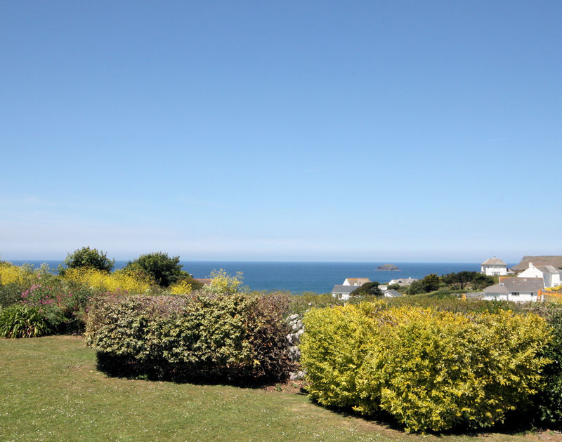 Mature hedging and far reaching sea views across the Atlantic Ocean from Trebartha, a self catering holiday house to rent in Daymer Bay on the North Cornish Coast.