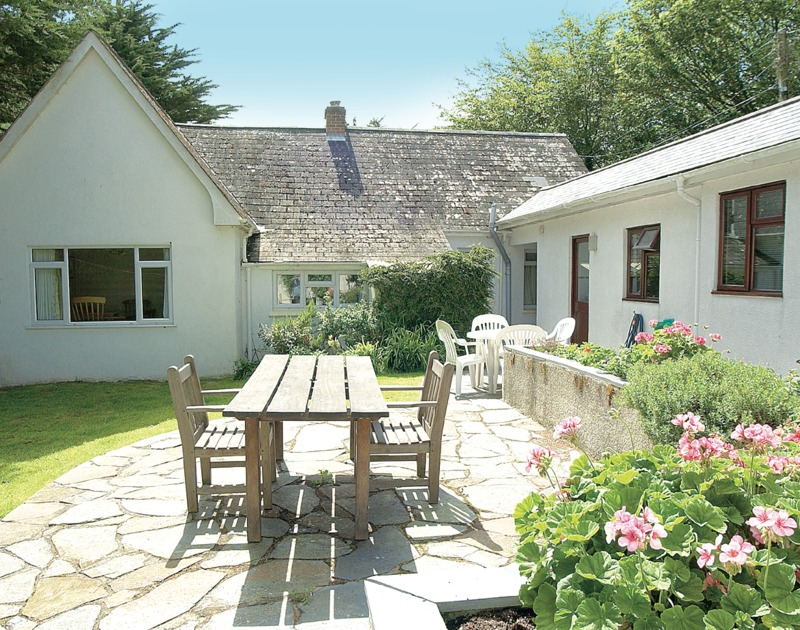 The sunny, furnished patio at Brookfield, a self-catering holiday house in Rock, Cornwall