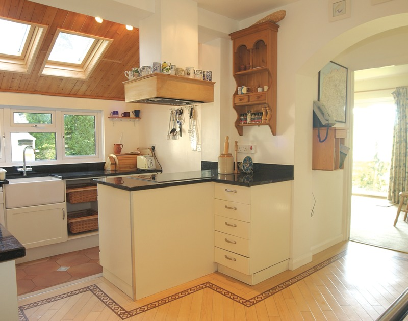 The attractive, characterful kitchen at Brookfield, a holiday rental in Rock, Cornwall, with deep butler sink.