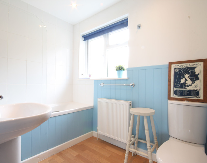 Attractive blue and white bathroom at Trevega, a holiday house in Polzeath, Cornwall