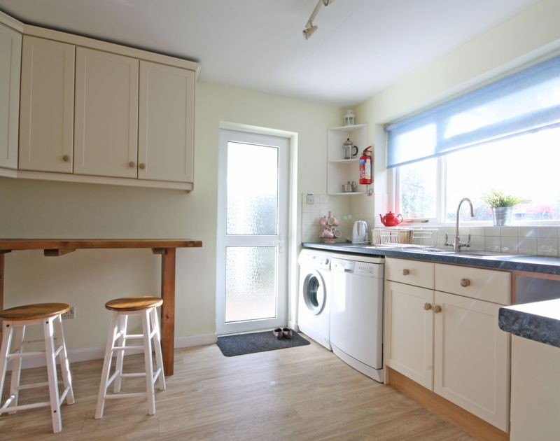 Practical, homely kitchen at Trevega, a self-catering holiday house in Polzeath, Cornwall