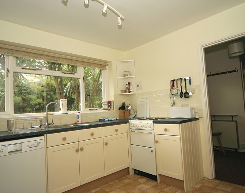 Well-equipped kitchen of Trevega, a self-catering holiday house in Polzeath, Cornwall