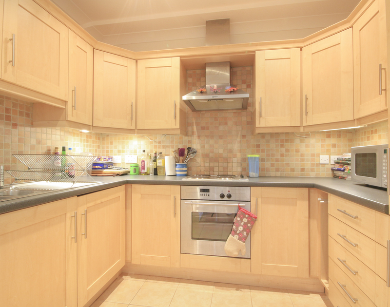 The well equipped kitchen at Lowenna Manor 9, a self catering holiday house to rent in Rock, North Cornwall.