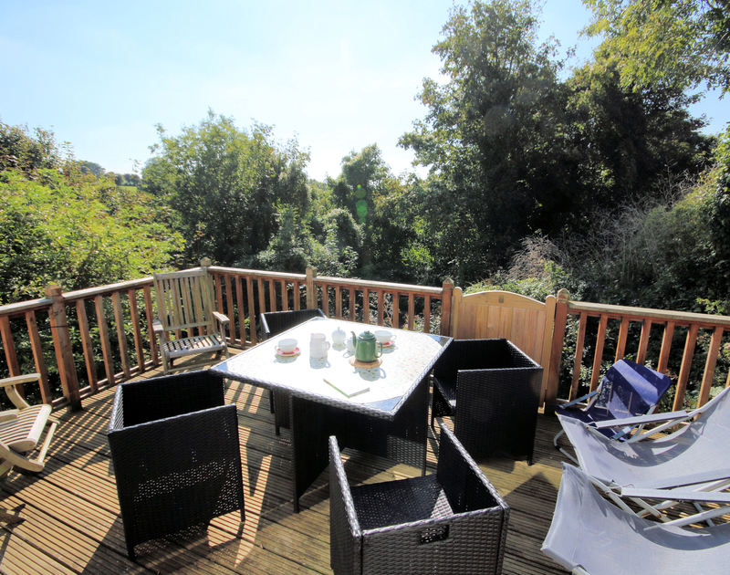 The balcony with wonderful rural views from its elevated position at Talland House, a holiday rental in Rock, North Cornwall.