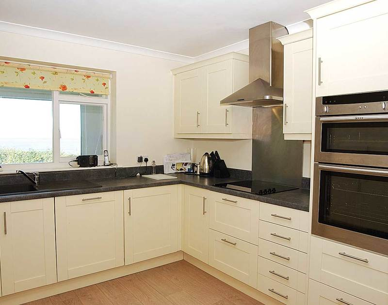 The smart kitchen in Trewint, a self catering holiday bungalow in a fantastic position over looking the sea and bay of Polzeath in North Cornwall.