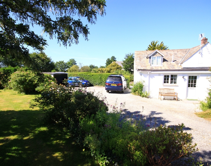 The pretty garden, driveway and ample parking outside Rose Cottage, a holiday rental in Rock, North Cornwall.