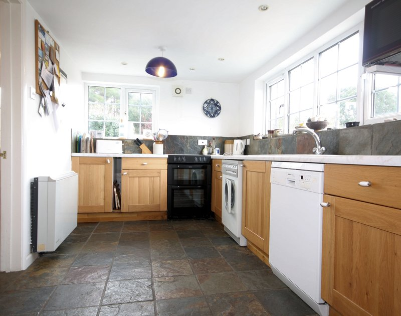 The bright, inviting kitchen at Rose Cottage, a self catering holiday cottage to rent in Rock, North Cornwall.