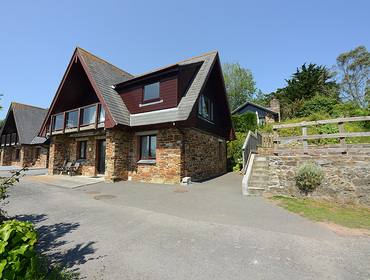 The exterior view of alpine-lodge style Fieldview, a tranquil holiday house in Rock, Cornwall.