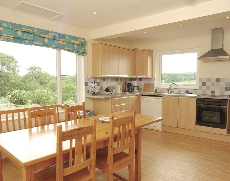 Countryside views from the sunny kitchen of Fieldview, a self-catering holiday house in Rock, Cornwall