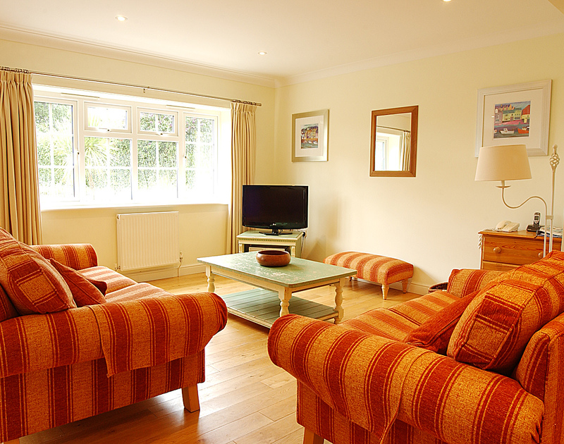 The comfy, attractive sitting room of Bodare 3, a holiday apartment to rent at Daymer Bay, Cornwall