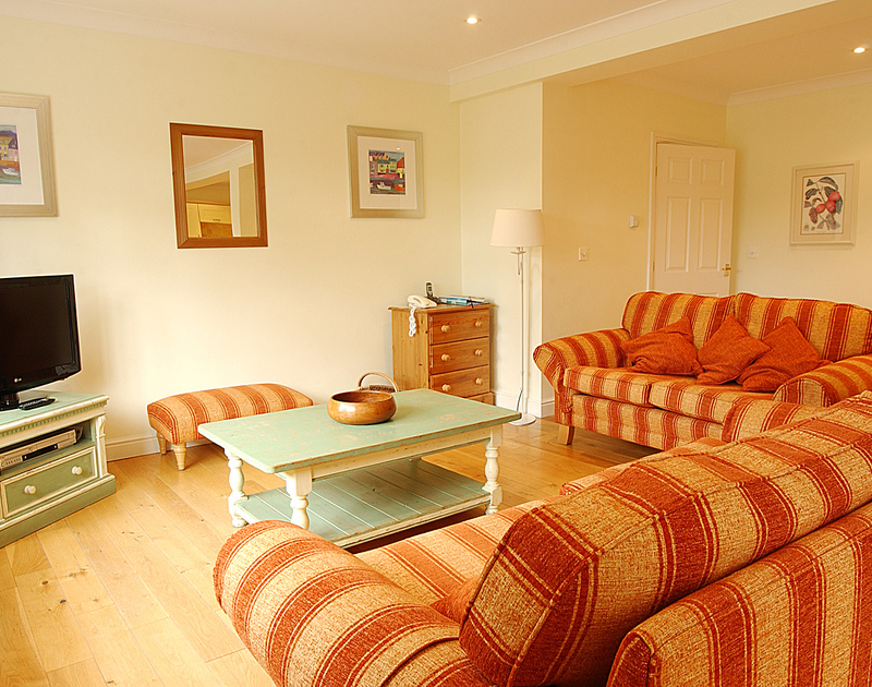 Snuggle up on the comfy sofas of Bodare 3, a holiday apartment at Daymer Bay, North Cornwall